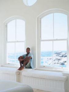 Happy man enjoying his freshly cleaned windows